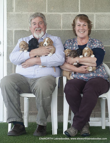 1-eric and JoAn with pups jpeg-001.jpg