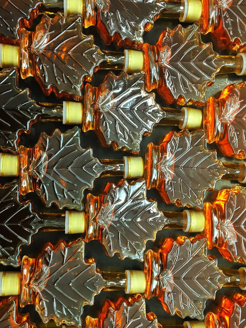 maple syrup. maple syrup glass leaf bottles