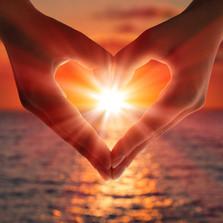 heart hands sunset.jpg