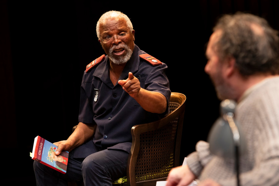 John Kani holds the book of King Lear