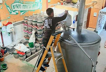 Person working on equipment in a brewery