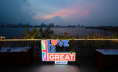 Love is Great logo displayed in front of a city skyline