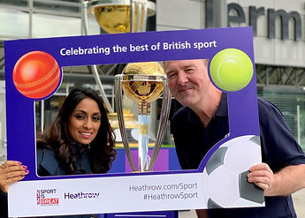 British sports stars posing in front of a trophy