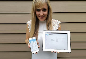 Woman holding an iPad and an iPhone