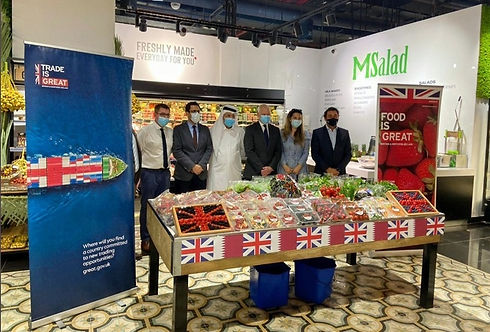Group of people stand by the display of the British produce in Qatar