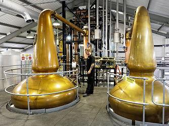 Man stood in a distillery