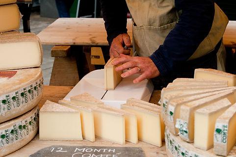 Trader cuts cheese..jpg