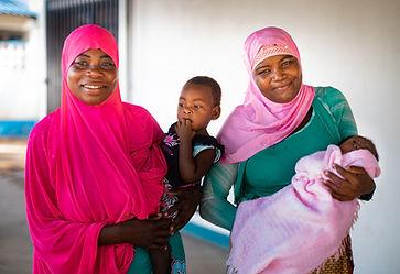 Local women in Mozambique holding children