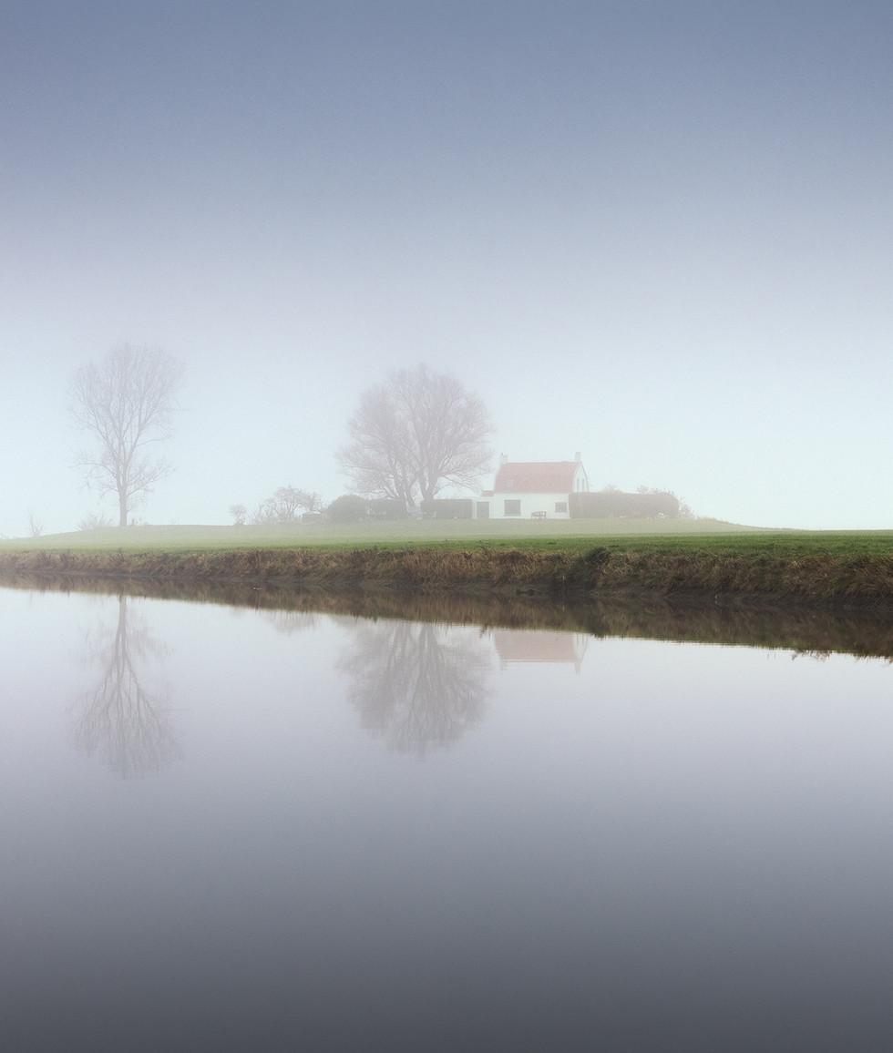 House on Mound in Mist, Zeeuws-Vlaanderen, Netherlands.jpg
