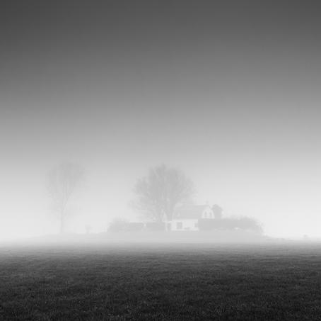 House on Mound in Mist, Zeeuws-Vlaanderen, Netherlands