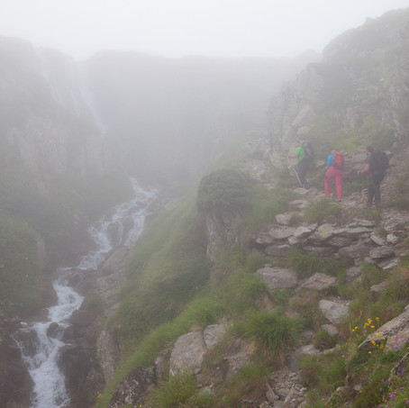 Hikers near Waterfall, Pyrenees, France