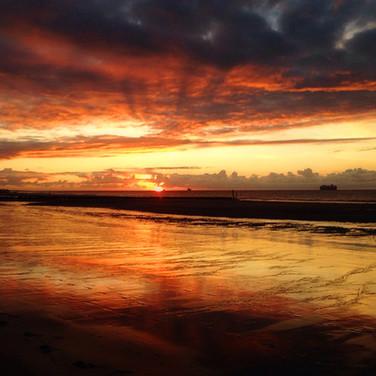 Zonsondergang strand Groede