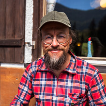 Harald Loffler or Hiking Harry eating Gröstl, Ackernalm, Tyrol, Austria