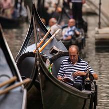 Having a Break in a Gondola, Venice, Italy