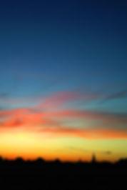 Zonsondergang boven Groede, foto genomen vanuit de achtertuin van bed and breakfast 't Zoete Peerd