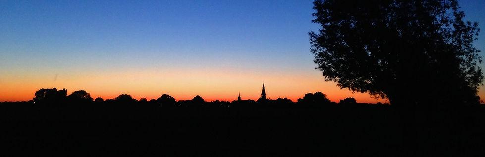 Uitzicht vanuit de achtertuin bij zonsondergang, B&B 't Zoete Peerd, Zeeland