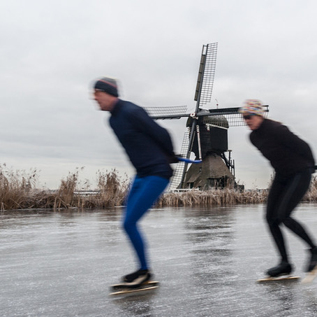 Skating along a Windmill, Kinderdijk, Zuid-Holland, The Netherlands