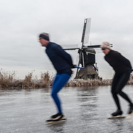 Skating along a Windmill, Kinderdijk, Zuid-Holland, The Netherlands