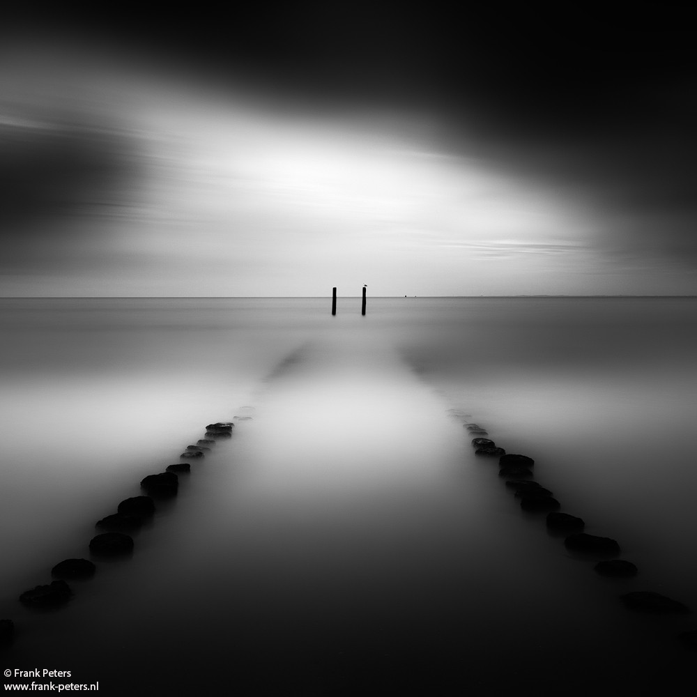 B&W long exposure image of groynes at the coast of Zeeuws-Vlaanderen