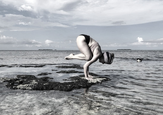Yoga milfontes practice at the beach