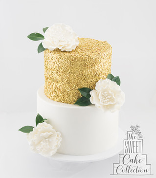 Gold Sequins and White Sugar Flowers on Fondant