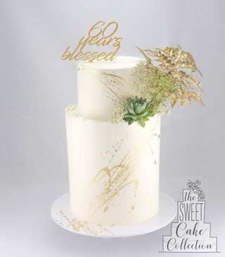 Smooth Buttercream with Gold Splatter and Flowers