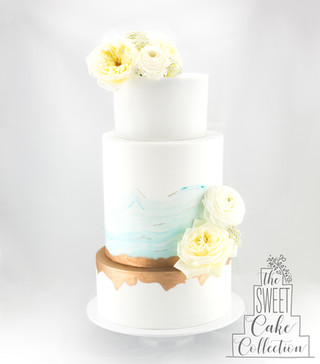 Painted Waves of Blue and Rose Gold on White Fondant
