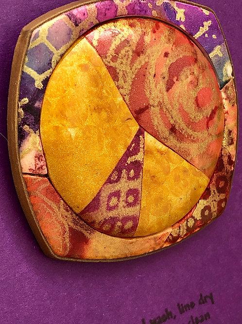 Framed circle focal button