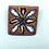 Thumbnail: Blue flower on brown