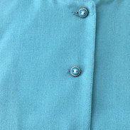 Buttons on turquoise top