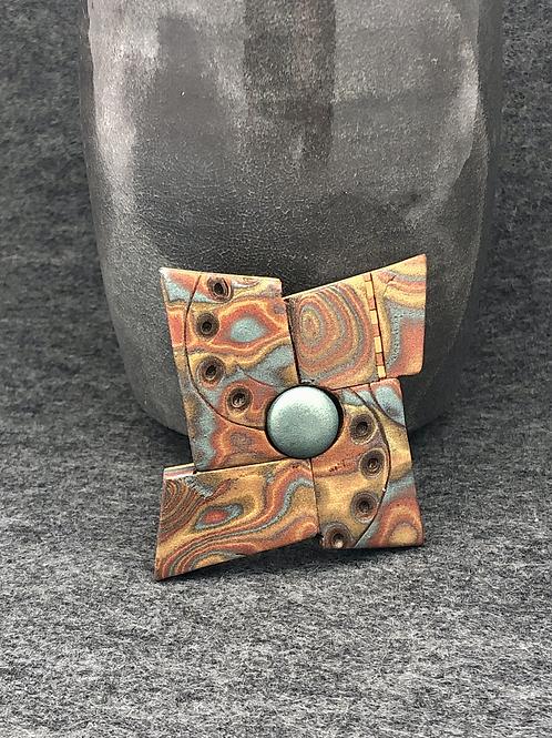 Pinwheel swirls brooch