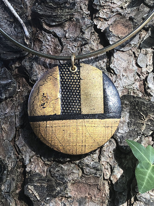 Textured metals circle pendant