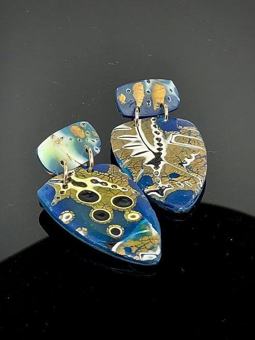 Large blue and gold mokume shields