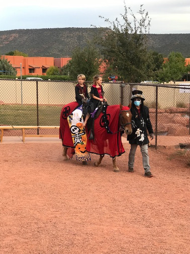 Dr. Scudder bringing the children around on horse back!