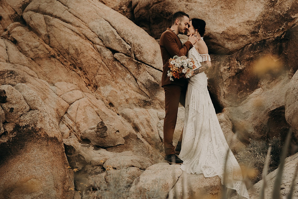Edgy tattoo boho bride and groom in tan suit lace reu de seine wedding dress and desert flowers