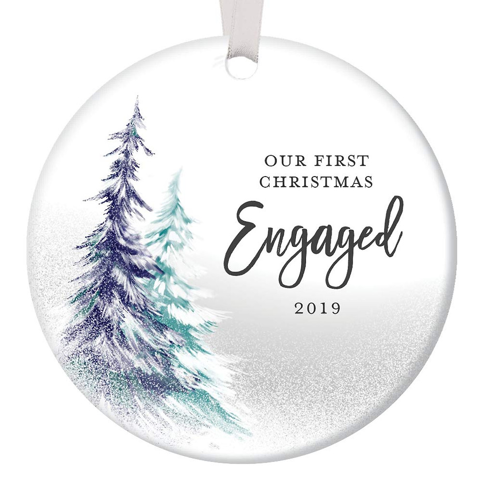 christmas ornament that says our first christmas engaged 2019