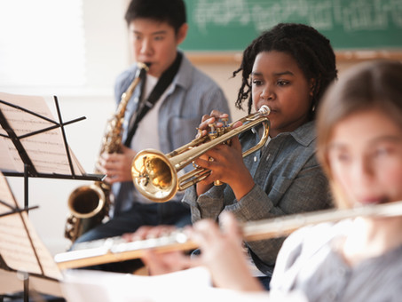 Three Benefits of Enrolling Your Child in Music School