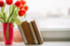 books-near-tulips_23-2147779303.jpg