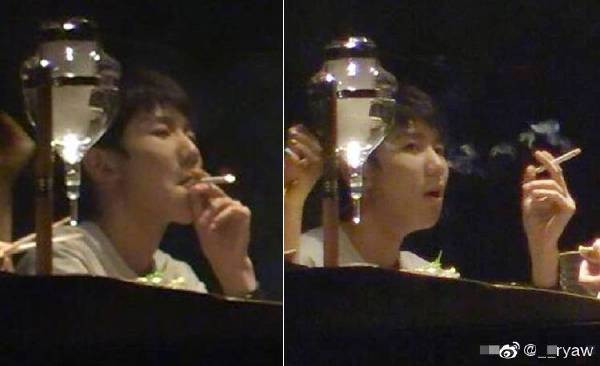 roy wang smoking inside a restaurant