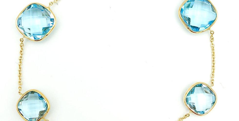 14 krt. Geelgouden armband met lichtblauwe topaas