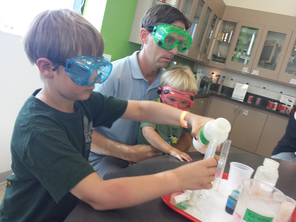 Family doing an experiment in the OMSI Chemistry Lab
