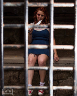 Female Chucky with Knife in a cage