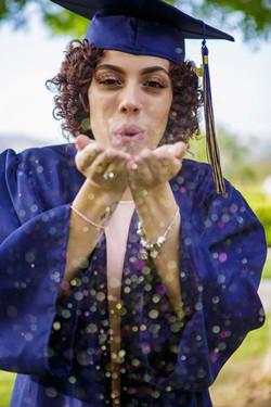 Senior blowing glitter