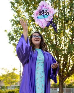 5th grade promotion grad tossing cap
