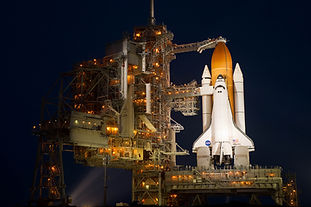 STS-135_lit_up_on_launch_pad_39a.jpg