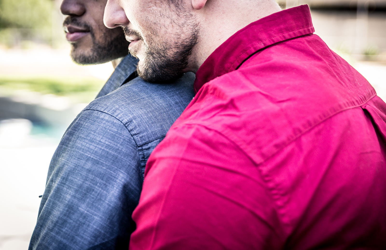 Black and White Gay Couples Embrace from