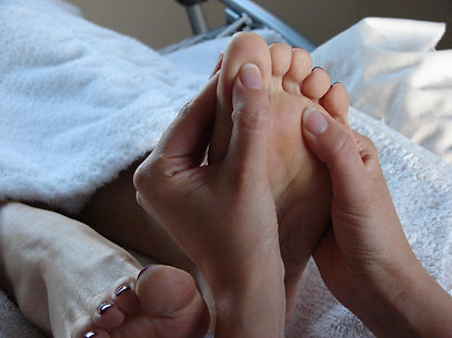 Foot reflexology to help combat stress and aid relaxation.