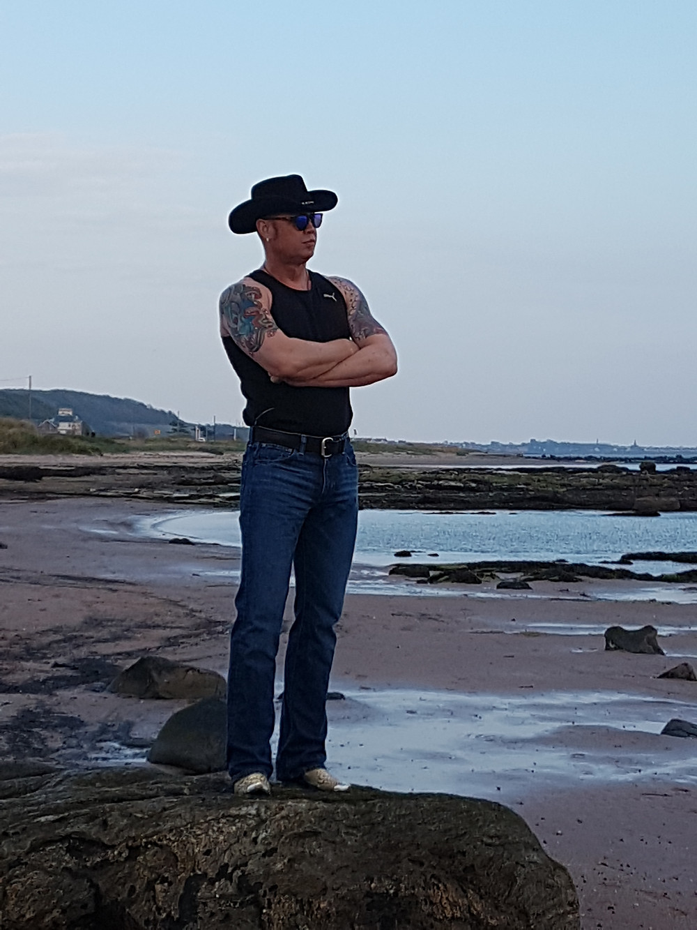 Bazz looking for inspiration on beach in Scotland