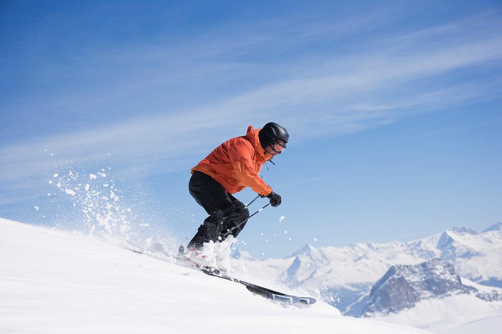 man on mountain skiing