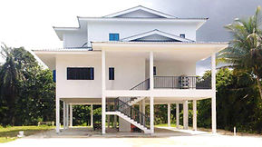 Two Storey House by Omera Construction in Brunei